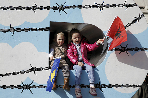 Kosovar children celebrate Kosovo Independence Day. (Photo: Reuters)