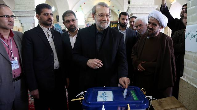 Iran's Parliament speaker Ali Larijani casts his ballot during national elections (Photo: AP)