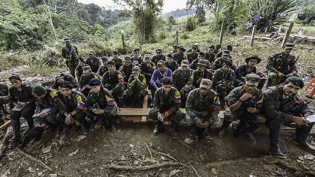 """לוחמי """"הכוחות המזוינים המהפכניים"""". ועדת אמת תחשוף עדויות על הפשעים (צילום: AFP) (צילום: AFP)"""
