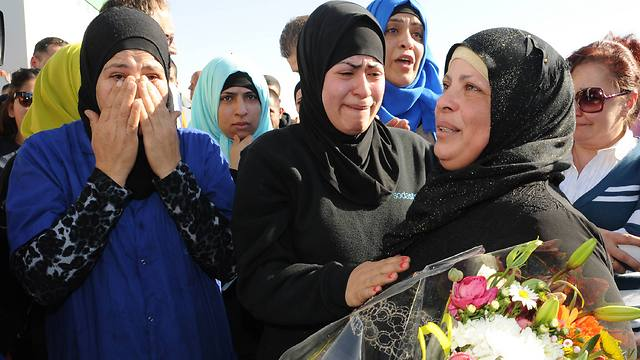 Saying goodbye in tears (Photo: Israel Yosef)
