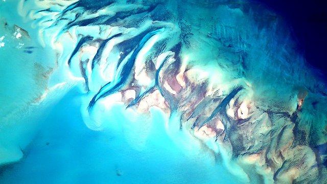 """תמונה שצולמה אתמול והכותרת שלה היא """"מים"""" (צילום: סקוט קלי, נאס""""א) (צילום: סקוט קלי, נאס"""