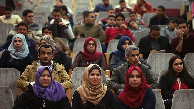 Gazans enjoying a film screening (Photo: Reuters)
