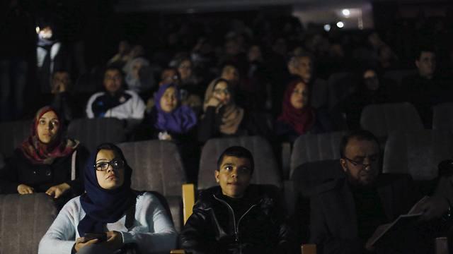 Gazans watching a movie (Photo: Reuters)