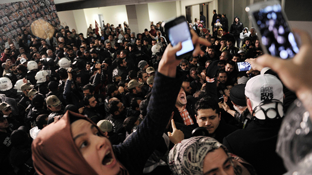 Protesters outside the Zaman building. (Photo: AP)