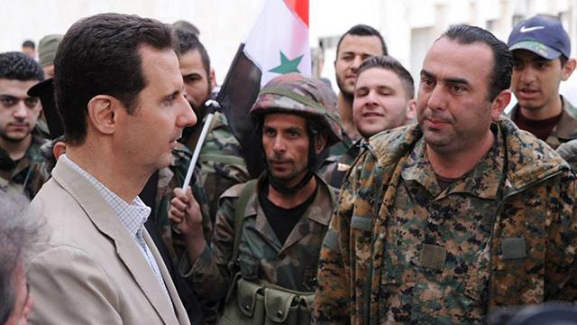 בשאר אסד באחת מהופעותיו הפומביות הספורות, לפני שנתיים ליד דמשק (צילום: AP) (צילום: AP)