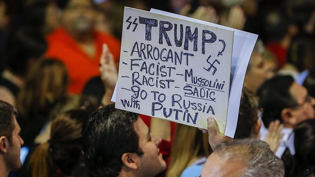 חצוף פאשיסט, גזען, לך לרוסיה. תומכי רוביו נגד טראמפ (צילום: EPA) (צילום: EPA)