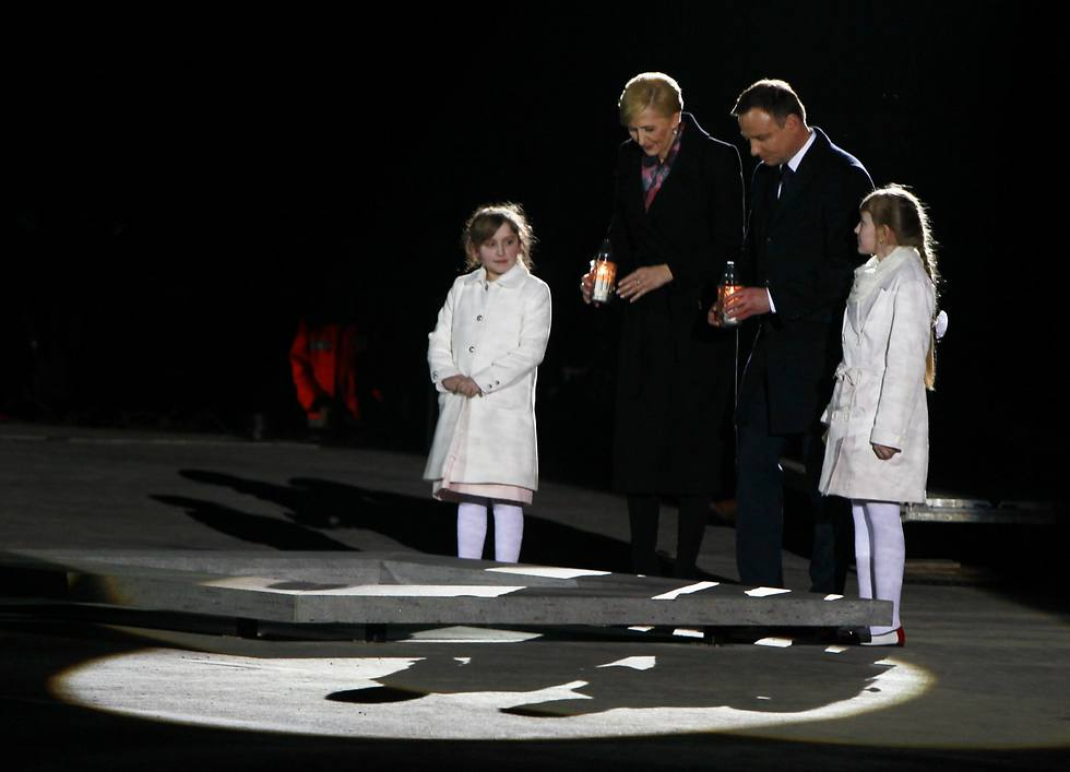 Poland's President Andrzej Duda and his wife Agata Kornhauser-Duda light a candle to officially open the Ulma Family Museum (Photo: AFP)