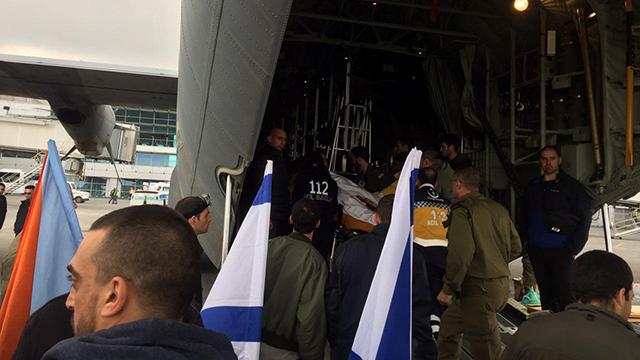 Avi Damri being placed on plane in Istanbul (Photo: Ran Boker)