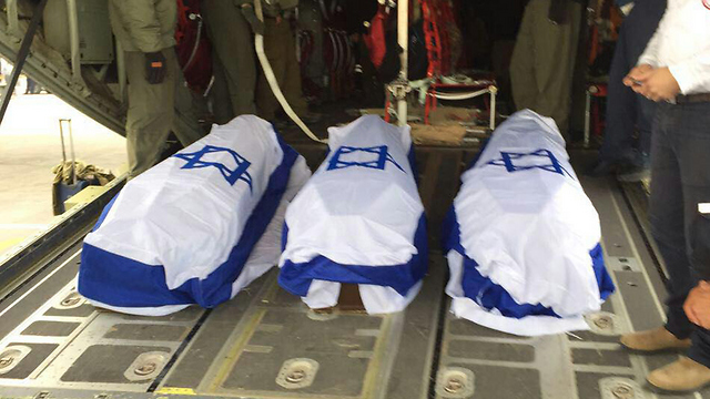 Coffins of the three murdered Israelis on the plane before returning to Israel