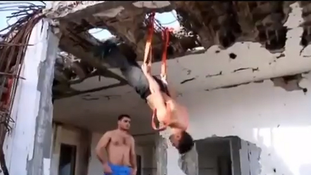 Gazans exercising in rubble