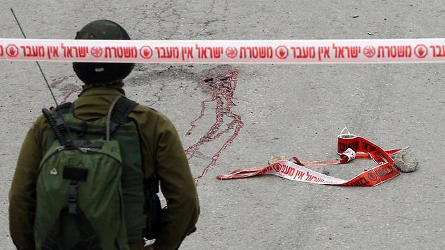 זירת הפיגוע והירי בחברון (צילום: AFP) (צילום: AFP)