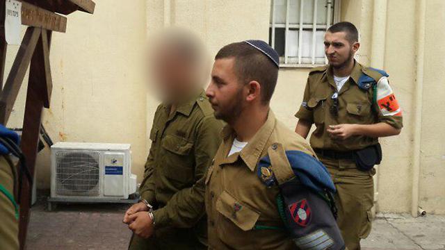 החייל שירה (מטושטש) בבית הדין הצבאי אתמול (צילום:  יואב זיתון) (צילום:  יואב זיתון)