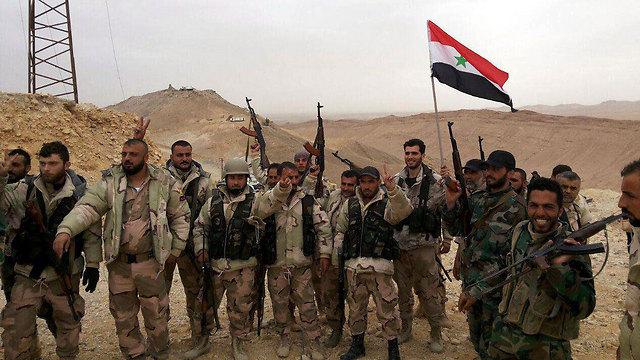 Syrian army troops in Palmyra (Photo: EPA)
