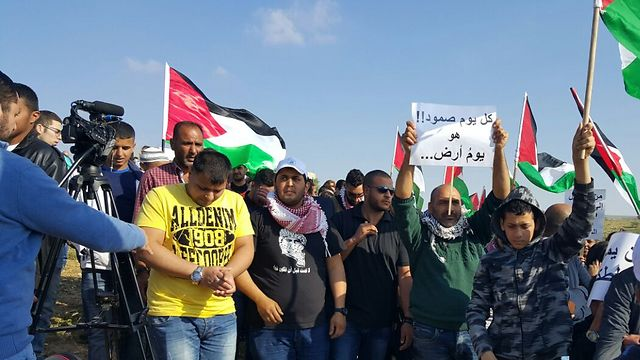 Palestinian flags at a Land Day protest in Umm al-Hiran
