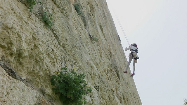 Rappelling down the walls of the Old City (Photo: Eli Mandelblum)