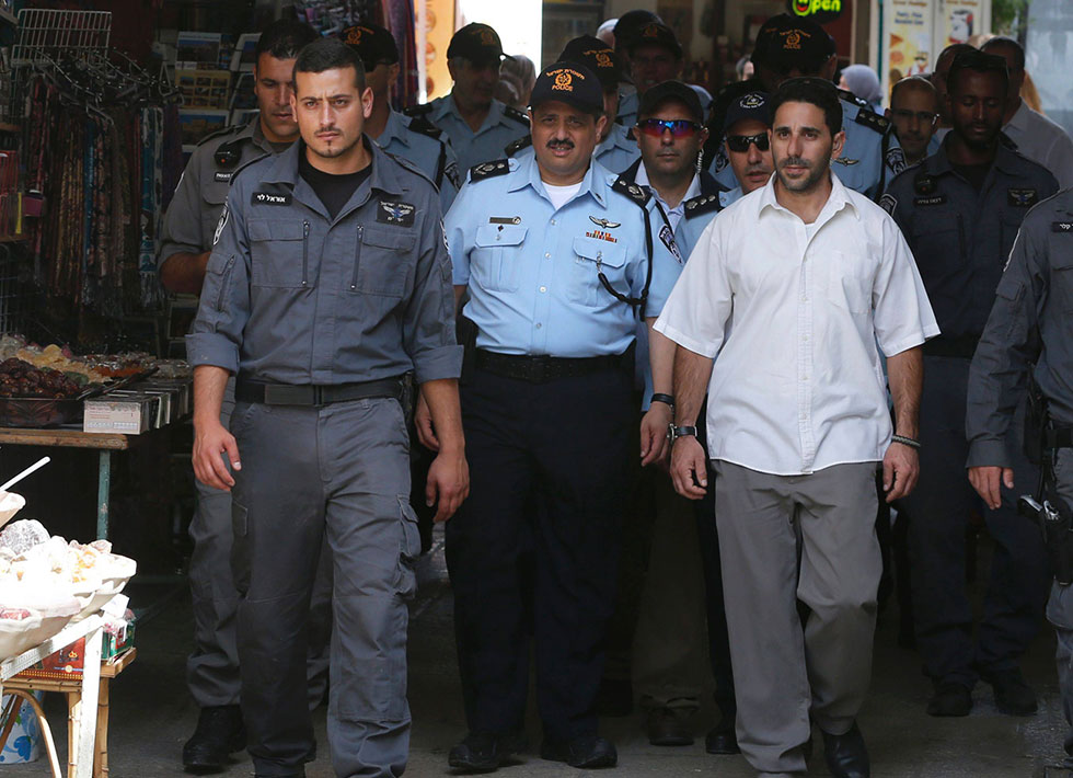 Police commissioner tours the Old City (Photo: AFP)