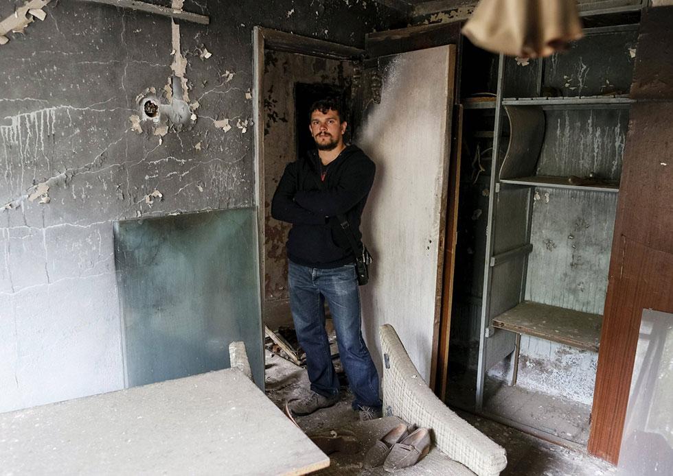 רומן צ'רנייבסקי, 32, חזר לדירה שנטשה משפחתו (צילום: רויטרס) (צילום: רויטרס)
