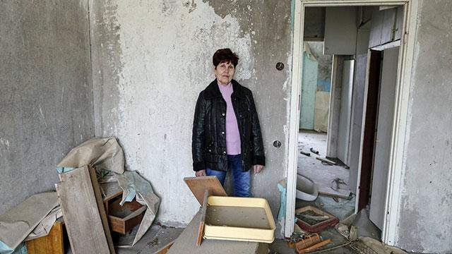 """""""ראיתי אנשים במסכות, אבל לא הסבירו לנו כלום"""". זויה פרבוזצ'נקו, 66 (צילום: רויטרס) (צילום: רויטרס)"""