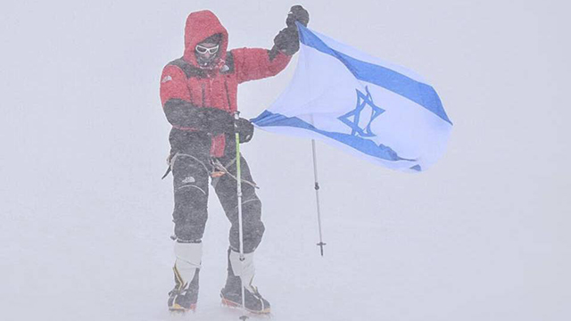 Nadav Ben Yehuda at the summit of Annapurna 1, the 10th highest mountain in the world