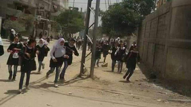תלמידות בסג'עייה נמלטות מחשש לתגובה ישראלית ()