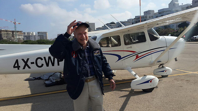 Mitchell Flint in front of the Cessna at Sde Dov Airport