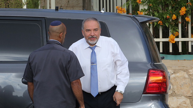 Lieberman this morning outside his home (Photo: Gil Yohanan)