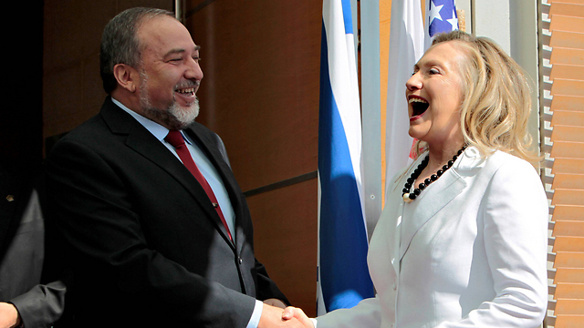 Liberman meets Hillary Clinton during his time as foreign minister    (Photo: Reuters)