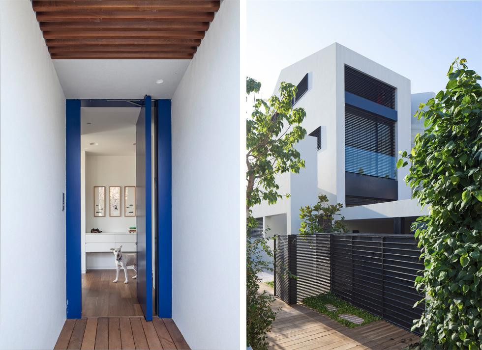 הבית צמוד לבית השכן, הוא בן ארבע קומות (כולל קומת מרתף), ונבנה על מגרש צר וארוך. שביל מתעקל מוביל מהרחוב אל דלת כניסה בכחול מפתיע (צילום: עמית גרון)