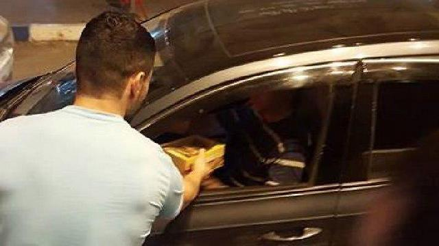 Palestinians in Tulkarem handing out cakes and cookies to celebrate the terror attack in Tel Aviv