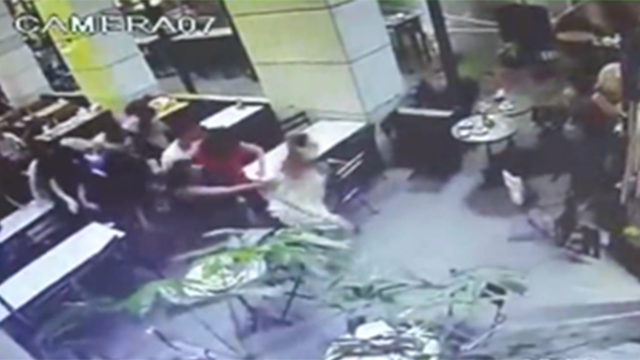 Security footage of the shooting attack at Tel Aviv's Sarona Market.