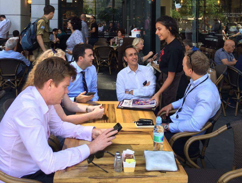 Sharma and his embassy staff at Sarona Market following the terror attack.