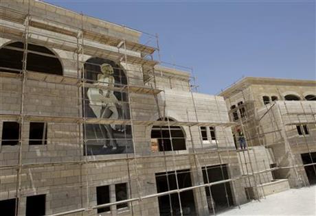 American actress Marilyn Monroe decorates an entertainment complex building under construction.