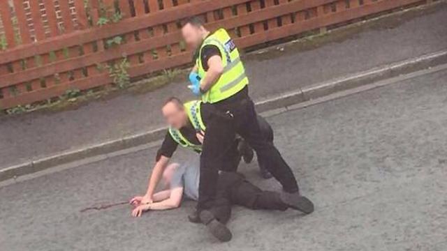 מעצרו של החשוד בירי ()