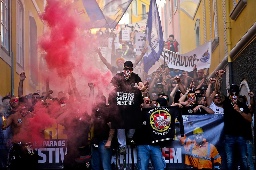 מחאת עובדי הנמל. ליסבון, פורטוגל (צילום: EPA)