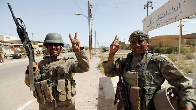 Iraqi troops celebrating their victory in Fallujah. (Photo: Reuters)