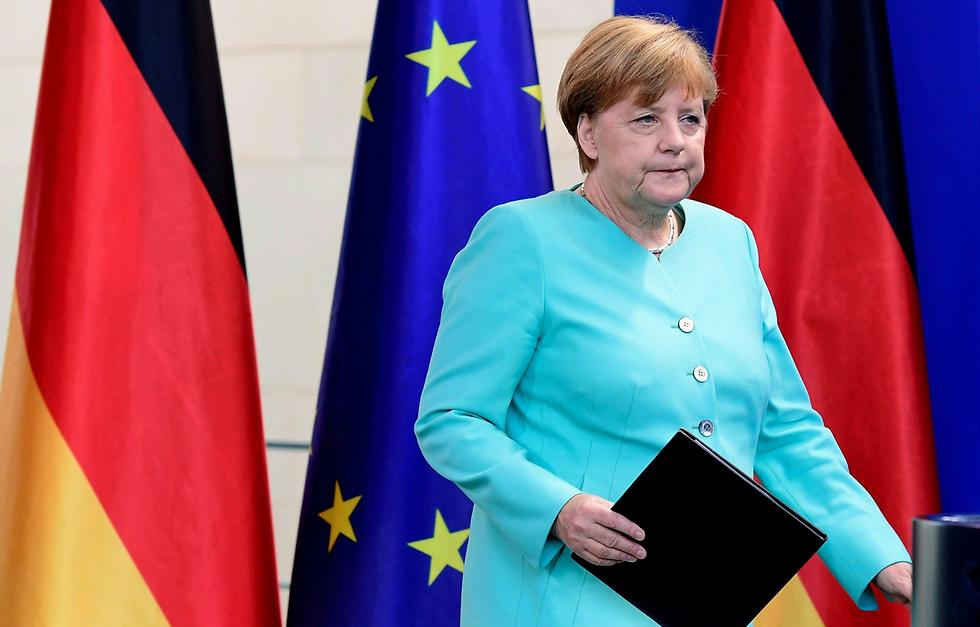"""""""הסוגייה לא אמורה להימשך לנצח"""". תגובת הקנצלרית (צילום: AFP) (צילום: AFP)"""