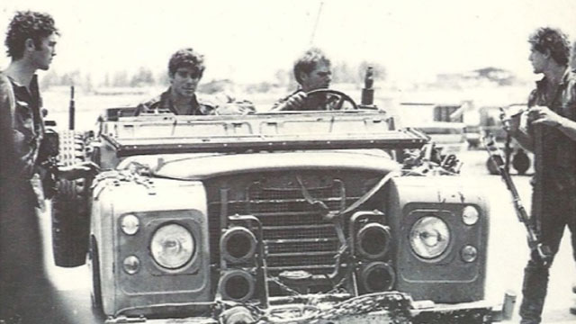 Left to right: Alex Davidi, Shlomi Reisman, Eyal Yardenai (driving) and Yonatan Gilad on one of the Land Rovers after returning from the operation.