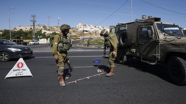 חיילים בקריית ארבע, ארכיון (צילום: AFP) (צילום: AFP)