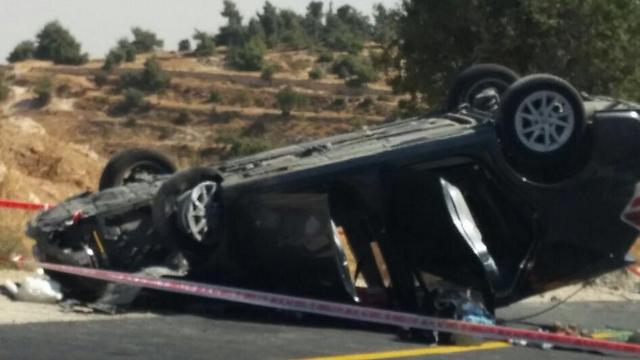 The Marks' flipped car (Photo: Har Hevron Regional Council)