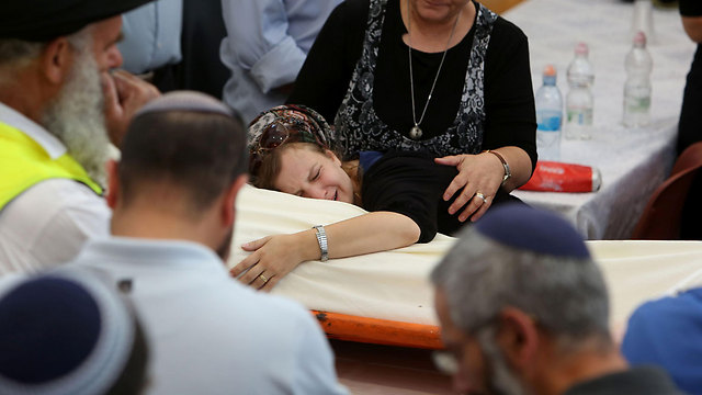 Miki Mark's funeral, Sunday. (Photo: AFP)