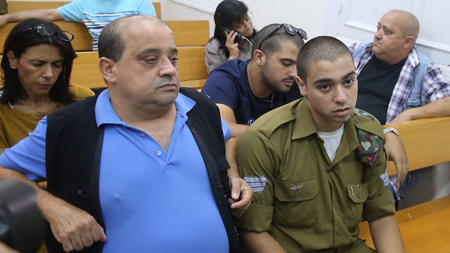 Sgt. Elor Azaria, right, in court with his father (Photo: Motti Kimchi)