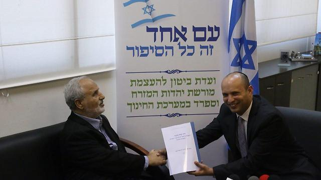 Commission chair Erez Biton submitting recommendations to Education Minister Bennett (Photo: Motti Kimchi)