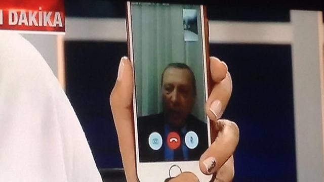 Erdogan speaking to Turkish TV via cellphone.