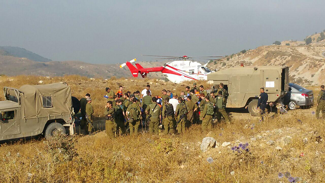 Injured soldiers are evacuated from the scene
