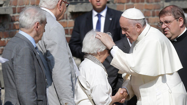 Francis addressing a survivor (Photo: Reuters)