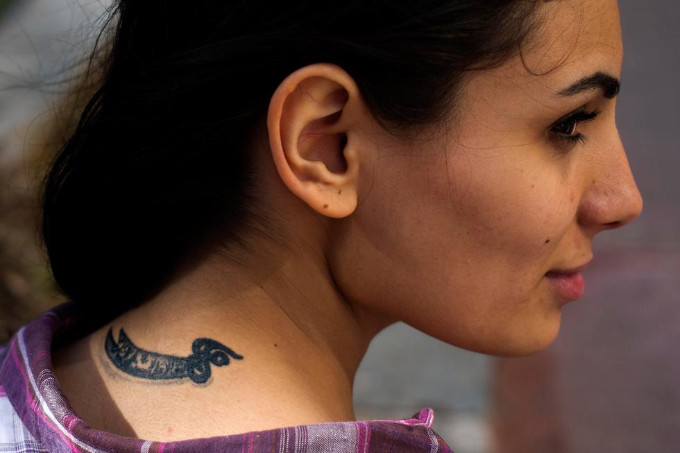 Farah Najm with her tattoo of Ali's sword (Photo: AP)