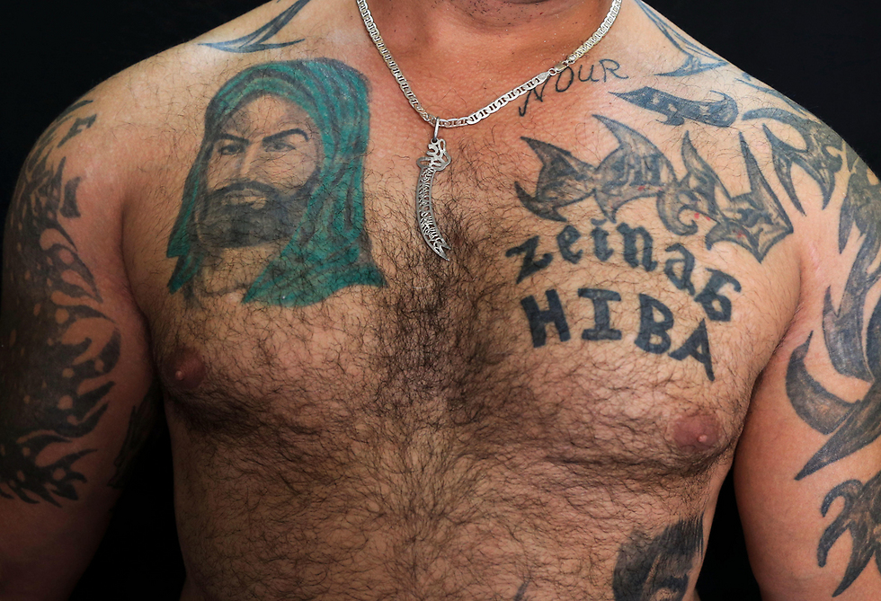Tattoos for Imam Ali and his daughter Zeinab (Photo: AP)