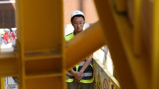 One of the Chinese foreign workers on the project (Photo: Motti Kimchi)