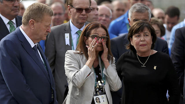 Ilana Romano, center, and Ankie Spitzer, right, widows of Israeli Olympic athletes killed at the 1972 Munich Olympics, attend a memorial in their husbands' honor, ahead of the Summer Olympics in Rio de Janeiro (Photo: AP)