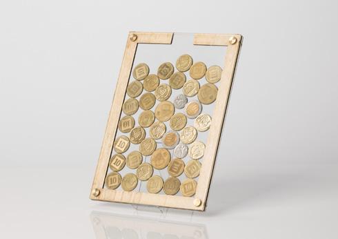 קופת המסגרת מציגה את המטבעות לסוגיהם לראווה (צילום: נמרוד גנישר)